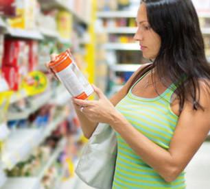 A consumer reads nutrition label in a store
